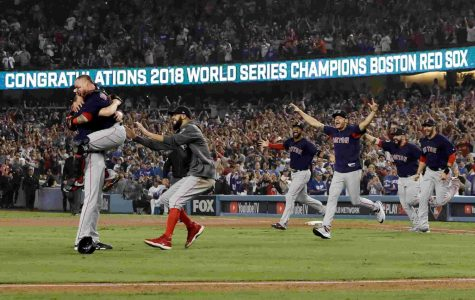 Boston Red Sox teammates rush on field after winning the 2018 World Series.