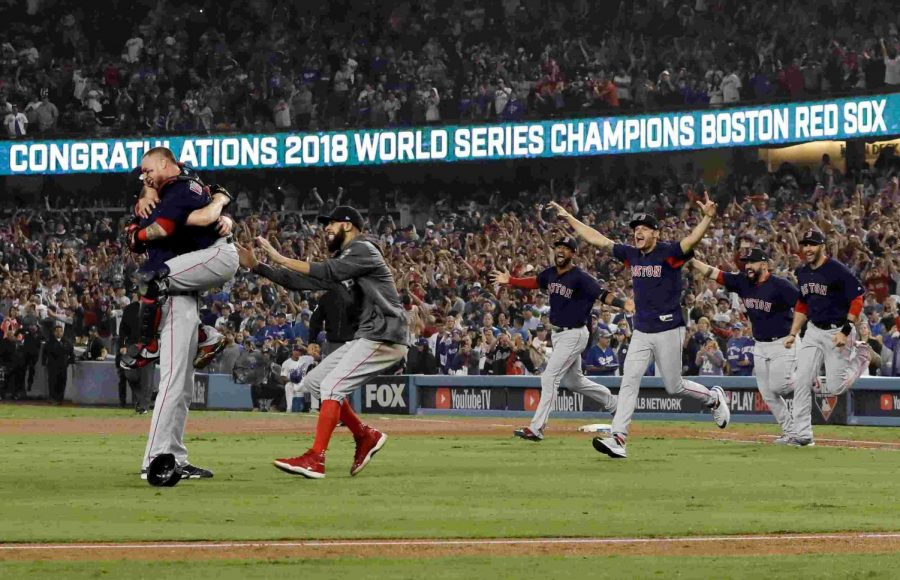 Boston+Red+Sox+teammates+rush+on+field+after+winning+the+2018+World+Series.
