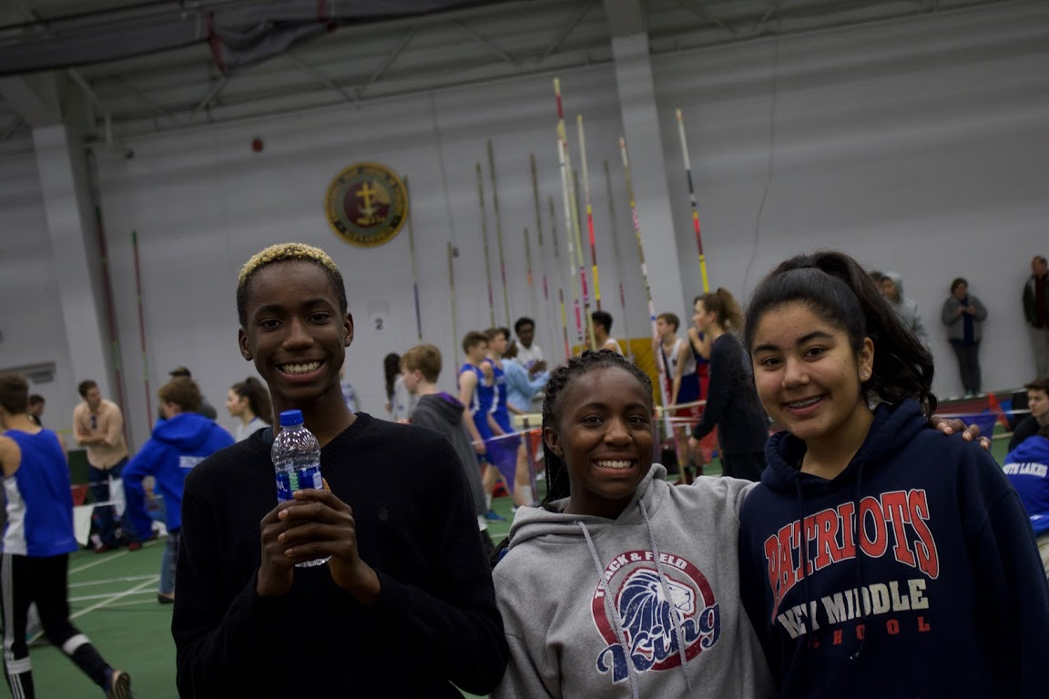 Track athletes Jariq Bevel, Amaria White, and Omyrah Alizai are all smiles between events at the Episcopal meet.