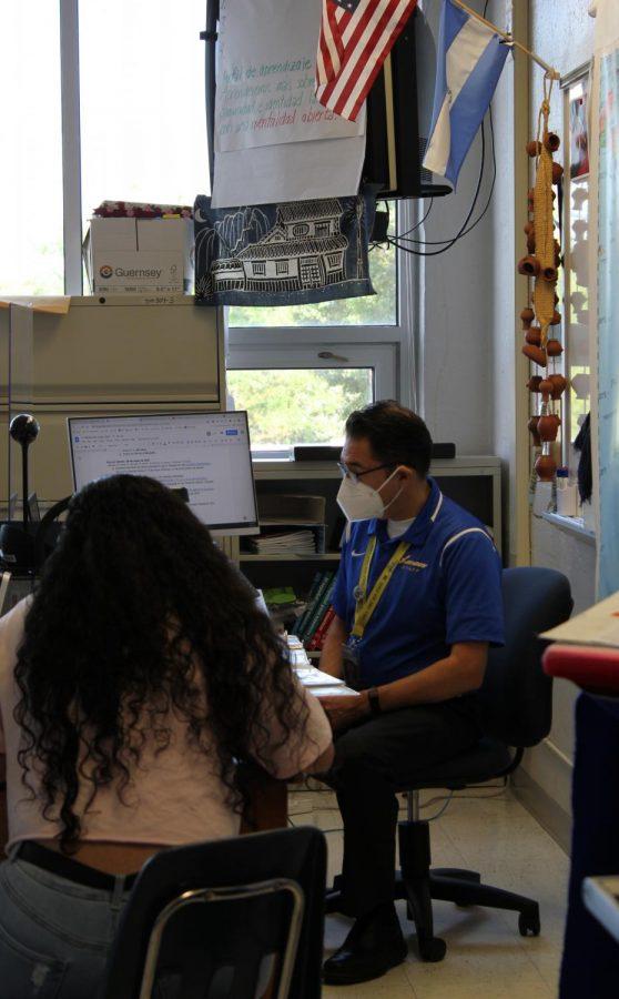 Spanish teacher Erik Giblin tests a student in Spanish for Fluent Speakers.
